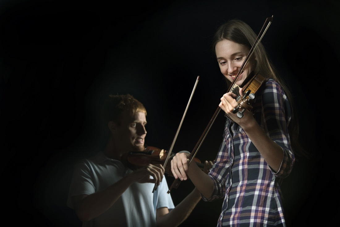 UALR students and traditional-style fiddlers Emily Phillips and Everett Elam photographed on Sept. 8, 2015, at Stella Boyle.