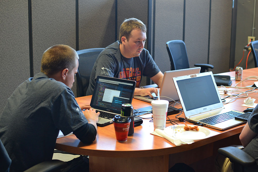 Gamemasters at work during recent UALR Hackathon event at The Venture Center in downtown Little Rock. (Photo submitted by The Venture Center)