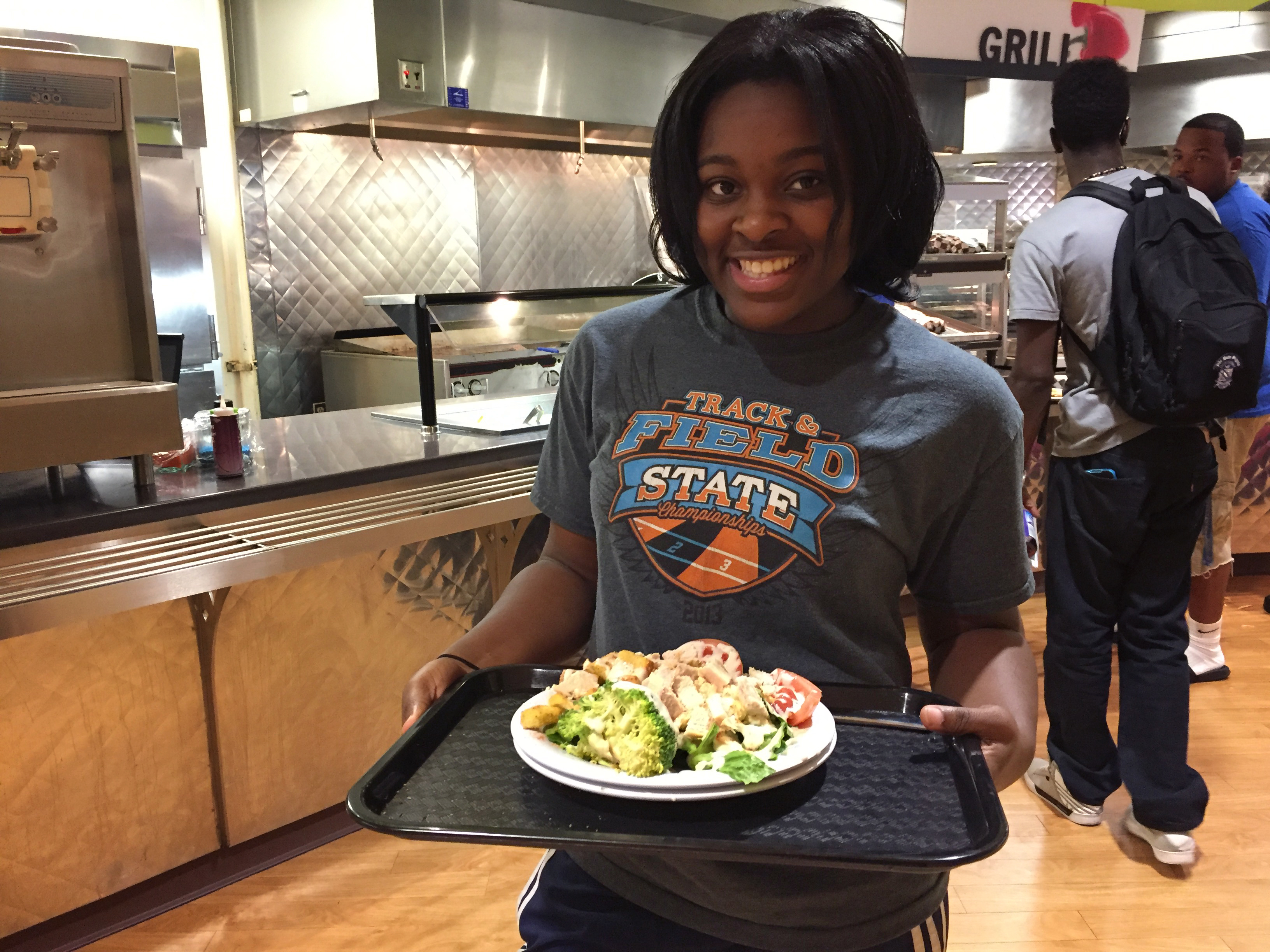 Student with food at Trojan Cafe