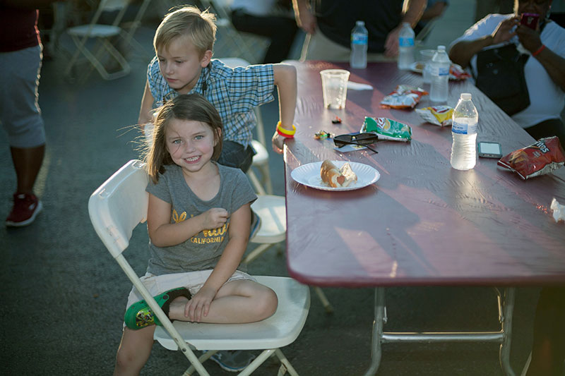 Children enjoy some food during the 2015 National Night Out observance on the UALR campus