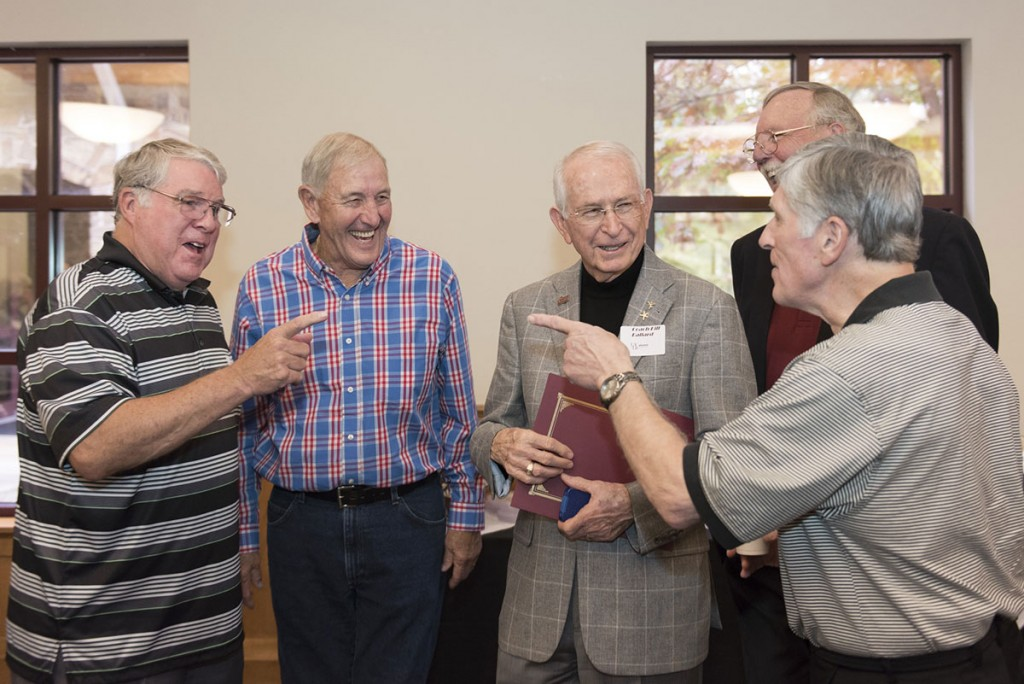 Coach Ballard shares a light moment with some of his basketball players from the 1960s