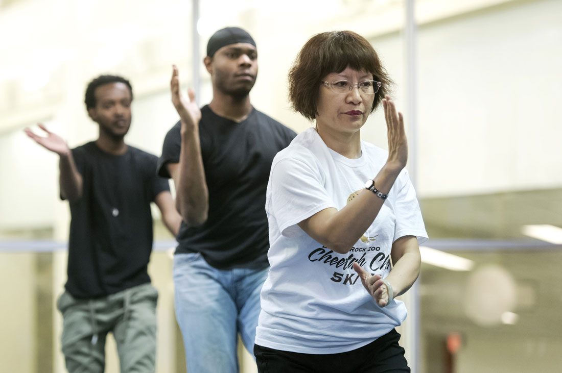 Visiting scholar, Huang Li, from Huaxia University in Xiamen, China teaches tai chi for the fitness center on Jan. 20, 2016, in DSC. Tai chi is an ancient Chinese tradition that, today, is practiced as a graceful form of exercise. It involves a series of movements performed in a slow, focused manner and accompanied by deep breathing.