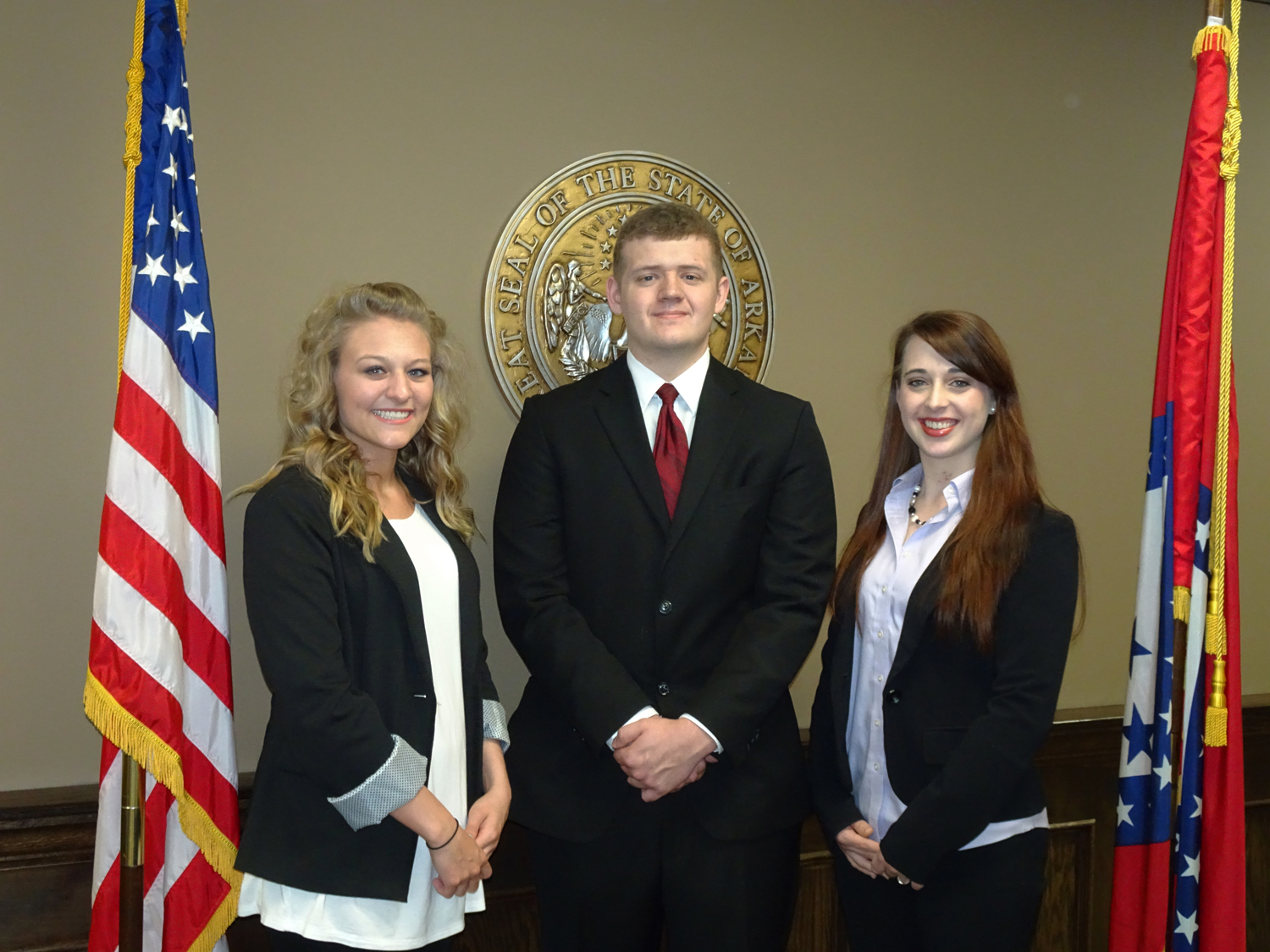 Group photo of the three interns at the Attorney General's office.