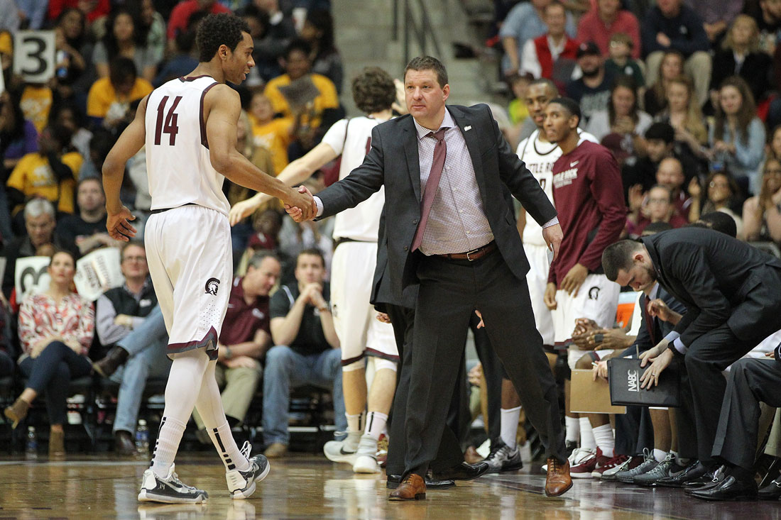 Trojans men's basketball Coach Chris Beard shakes a player's hand during a recent game