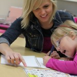 Staff at Nixa School District in Missouri work with a student on a reading lesson. Contributed photo