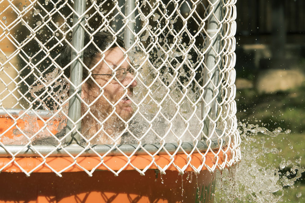A dunk tank volunteer emerges from the water during the 2015 Carnival of Clubs event