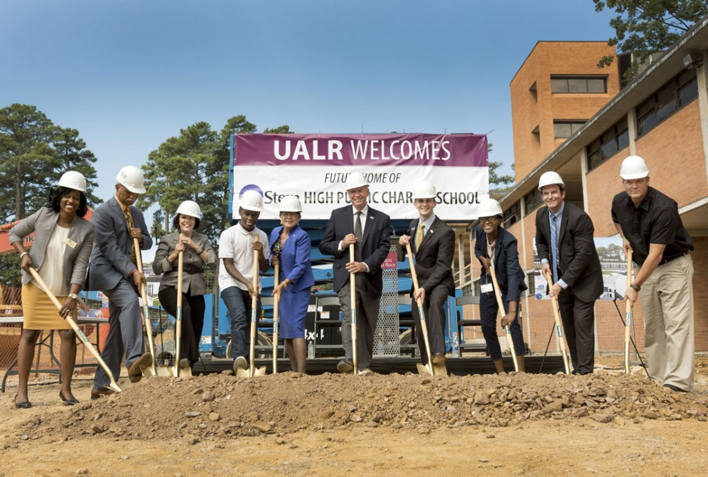 Officials from eStem and UALR break ground during a ceremony at the future site of eStem High School.