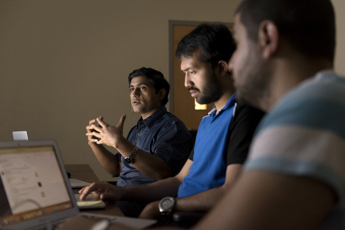 Dr. Nitin Agarwal (left) and his doctoral students, Nihal Hussain and Samer Al-Khateeb. Photo by Lonnie Timmons III/UALR Communications.