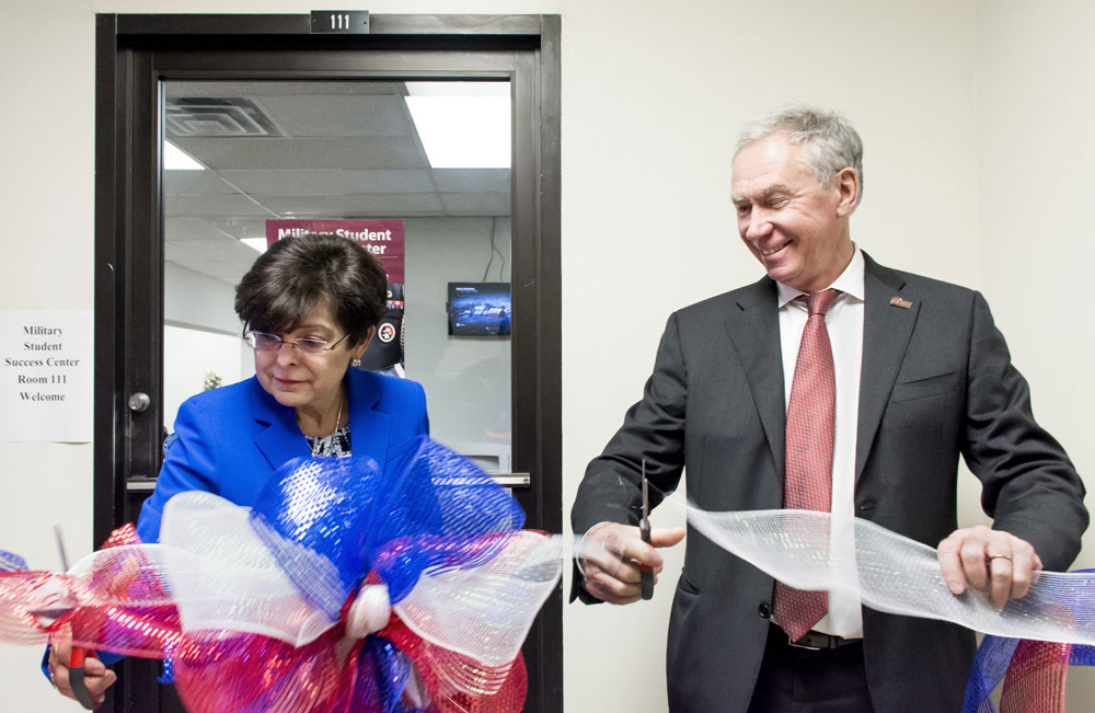 Executive Vice Chancellor and Provost Zulma Toro and Chancellor Andrew Rogerson cut the ribbon on UALR's new Military Student Success Center Dec. 16 in the UALR Speech Building. Photo by Rayna Mackey.