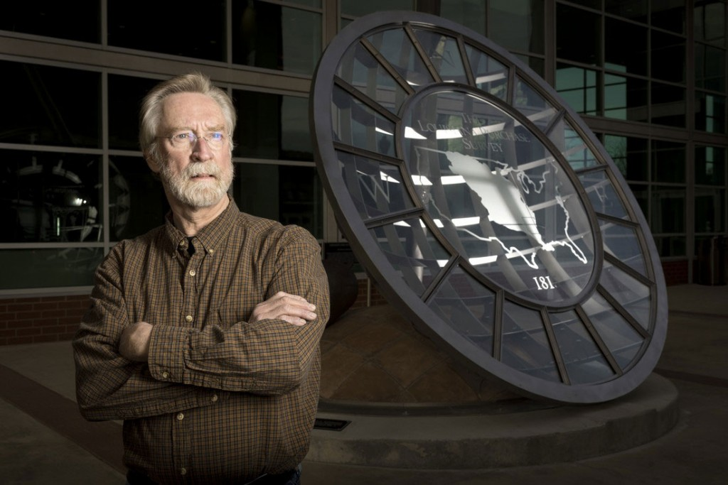 """Michael Warrick stands by his sculpture, """"Straight Lines on a Round World,"""" in front of the Statehouse Convention Center in downtown Little Rock, which commemorates the 200th anniversary of the Louisiana Purchase Survey."""