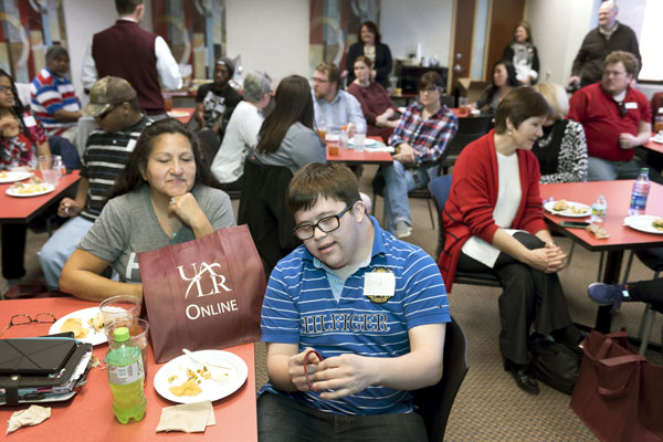Participants and family members enjoy a reception at UA Little Rock in honor of a new program to help students with intellectual and developmental disabilities enter the workforce. The program is a partnership between the university and Easterseals Arkansas.