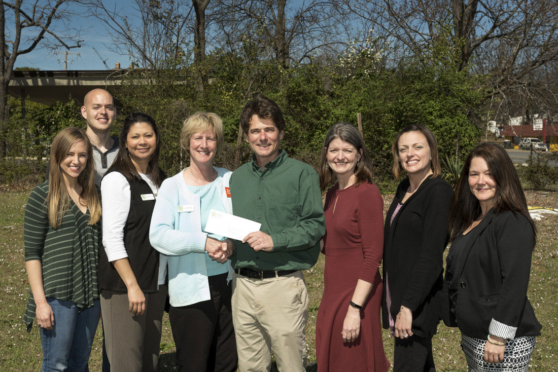Pictured from left to right are Amber Mitchell, president of the Campus Garden Alliance, John Poole, Campus Garden Alliance member, Temeka Williams, operations director of the Arkansas Hunger Relief Alliance, Patty Barker, director of the Arkansas No Kids Hungry Campaign, Stephen Grace, professor of biology and Campus Garden Alliance faculty advisor, Betsy Hart, director of the Trojan Food Pantry, Whitney Bradford, assistant director of the Trojan Food Pantry, and Sarah Beth Estes, director of the Community Connections Center. Photo by Lonnie Timmons III/UA Little Rock Communications.