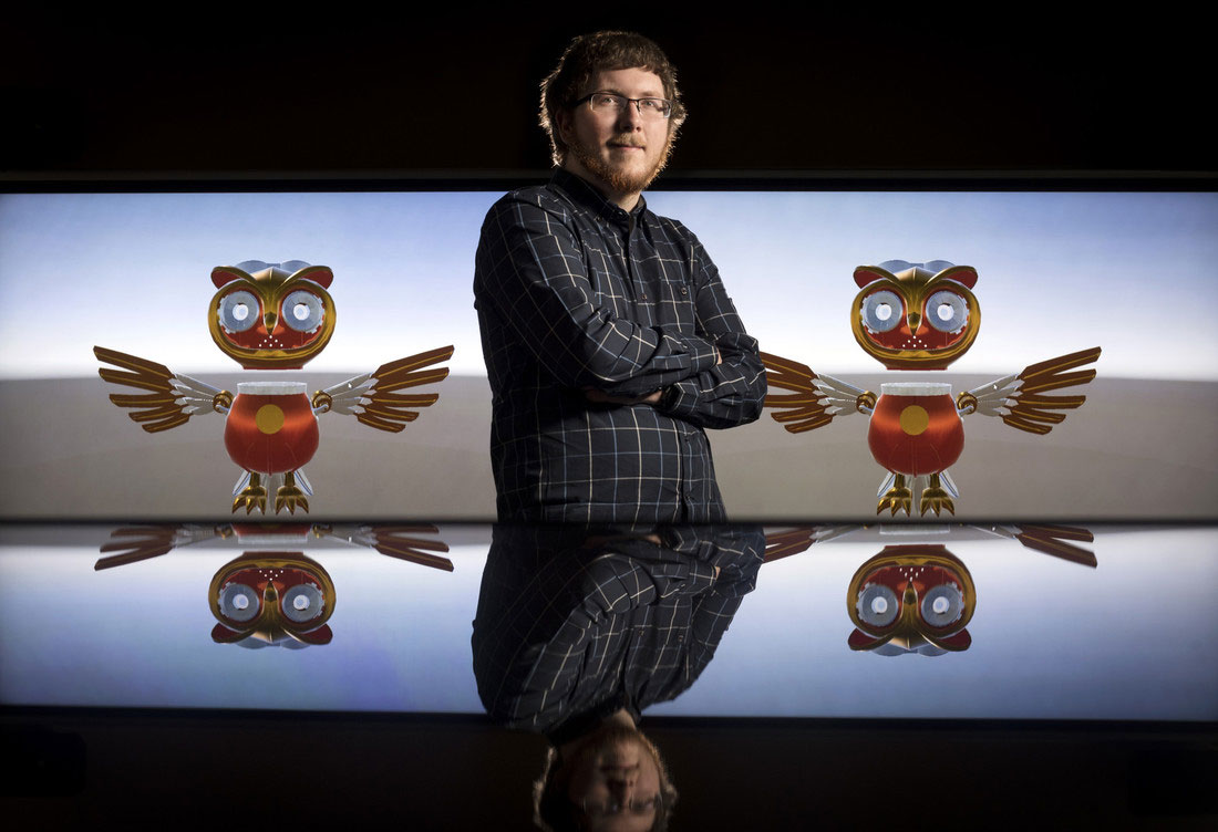 "Connor Young, a first-year integrated computing doctoral student from Springdale, is using his research in facial recognition to create ""WhoNu,"" a virtual owl tour guide that will welcome guests at the Emerging Analytics Center,"