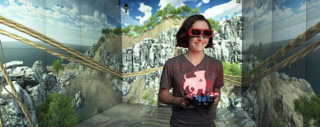 Emerging Analytics Center Student Researcher Loki Rasmussen explores Pirate Island in the CAVE. Photo by Lonnie Timmons III/UA Little Rock Communications.