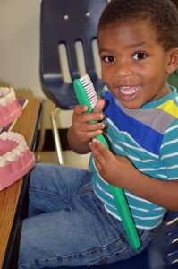 Head Start student Collin Talbert has his first dental visit at Future Smiles Dental Clinic.