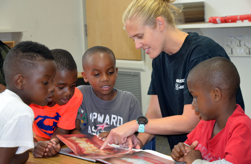 Dr. Missy Collins, a dentist at Arkansas Children's Hospital, discusses dental health with a group of children at the Future Smiles Dental Clinic.
