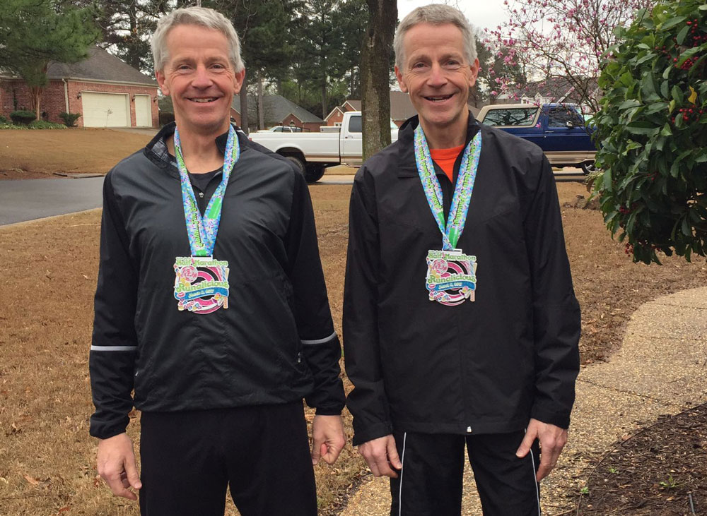 Kurt Lenser (left) and his twin brother, Karl Lenser (right), earned the top two spots in the men's 55-59 age group at the Little Rock Half-Marathon.