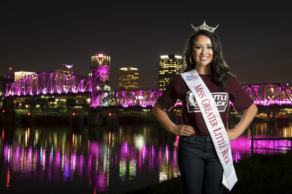 Brooke Cornelius, Miss Greater Little Rock, is an advocate for anti-bullying. She poses on the Junction Bridge with her UA Little Rock gear showing her school spirit.