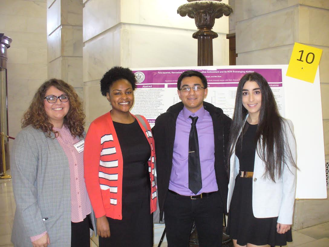 Four of the six students from UA Little Rock who present science, technology, engineering, and mathematics research at the Capitol.