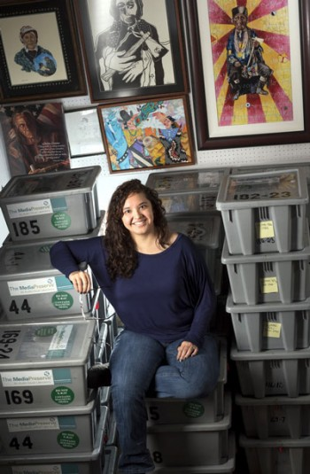 Stephanie Rabaduex works to digitize photos for the Sequoyah National Research Center.