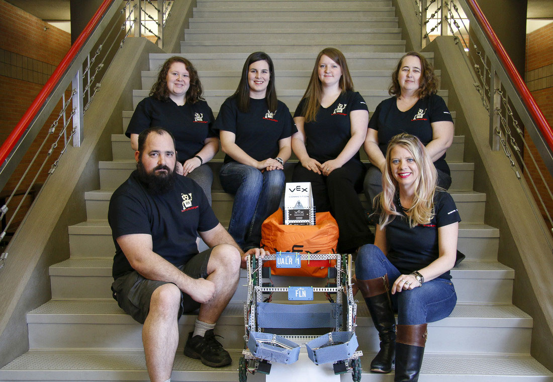 The Just a Prototype robotics team members include: Back row (L-R) Jamie Burrows, Rachel Smith, Shala Nail, and Donetha Groover. Front row (L-R) David Shurley , FLN the robot, and Faculty Advisor Sandra Leiterman.