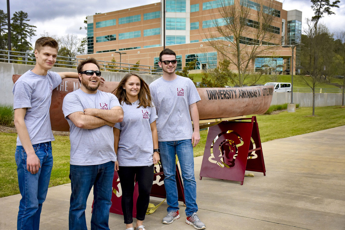University of Arkansas at Little Rock students display a concrete canoe built for the American Society of Civil Engineers Deep South Conference. Team members (L-R) include Logan Snapp, Manvill Allen, Harrison Hayworth, and Hunter Hobby. Photo by Joe Kline Jr./UA Little Rock Communications.