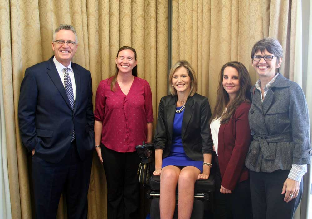 Pictured, from left to right, are Michael Hunter Schwartz, dean of the Bowen School of Law; scholarship winners Nicole Winters, Jennifer Goodwin, and Nicole Paladino; and Theresa Beiner, associate dean for academic affairs at Bowen. Photo by Nick Popowitch/Daily Record.