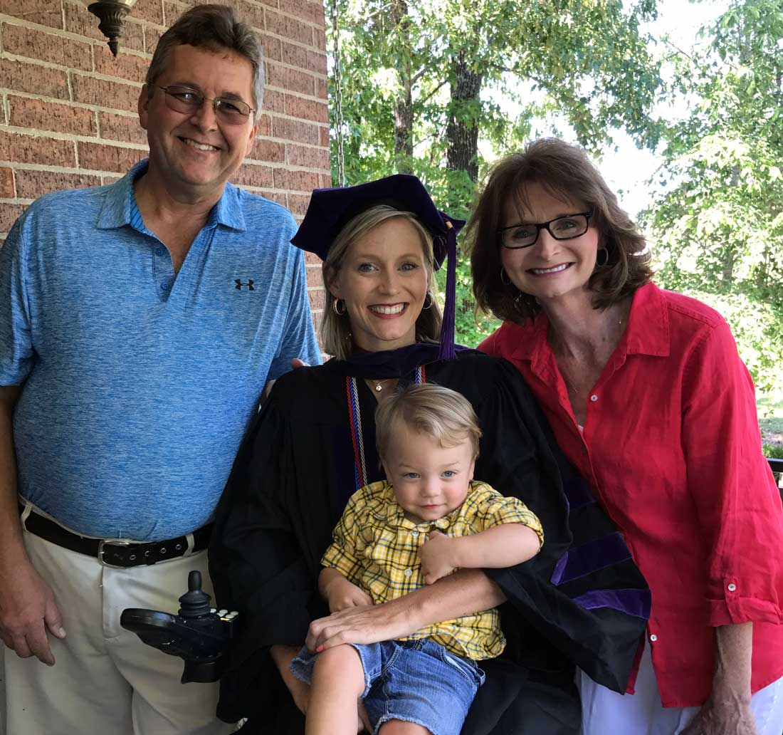 Jennifer Goodwin celebrates her graduation from Bowen School of Law with her parents, Robby and Tracy Goodwin, and son, Beckham.