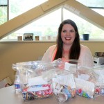 Ashley Henry-Saorrono is surrounded by car care kits for the homeless she created with the Saline County Progressives.