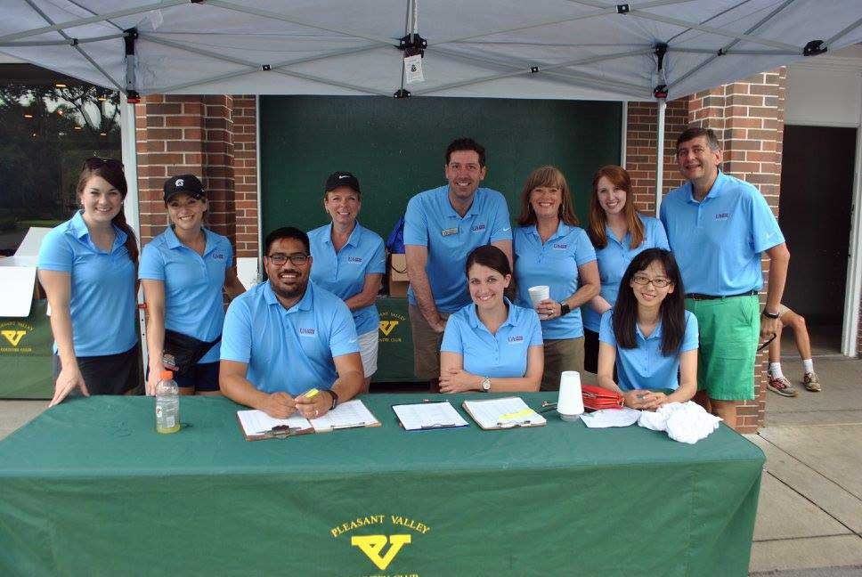 Volunteers help raise money for student success initiatives during the sixth annual University of Arkansas at Little Rock College of Business Golf Tournament June 12 at Pleasant Valley Country Club.