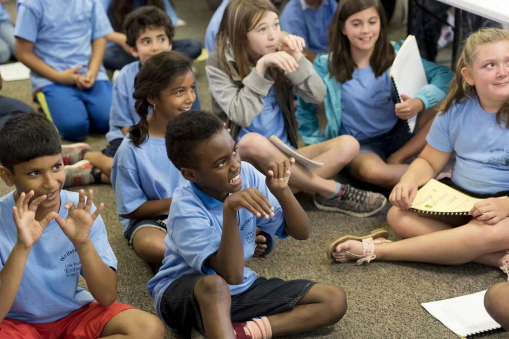 Participants in UA Little Rock's Young Writers Camp offer positive affirmations to inspire their fellow campers to read aloud in front of the group. Photo by Lonnie Timmons III/UA Little Rock Communications.