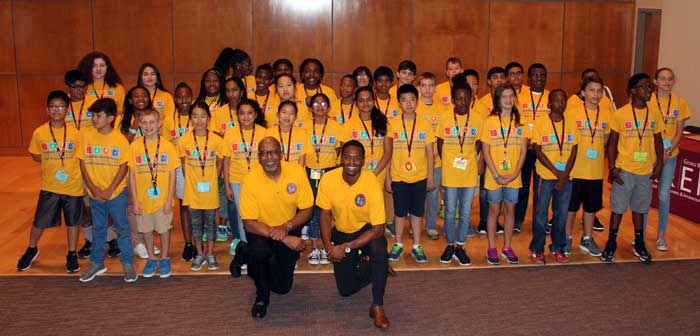 Former astronaut Bernard Harris visits with the 36 students at the ExxonMobil Bernard Harris Summer Science Camp held at the University of Arkansas at Little Rock.