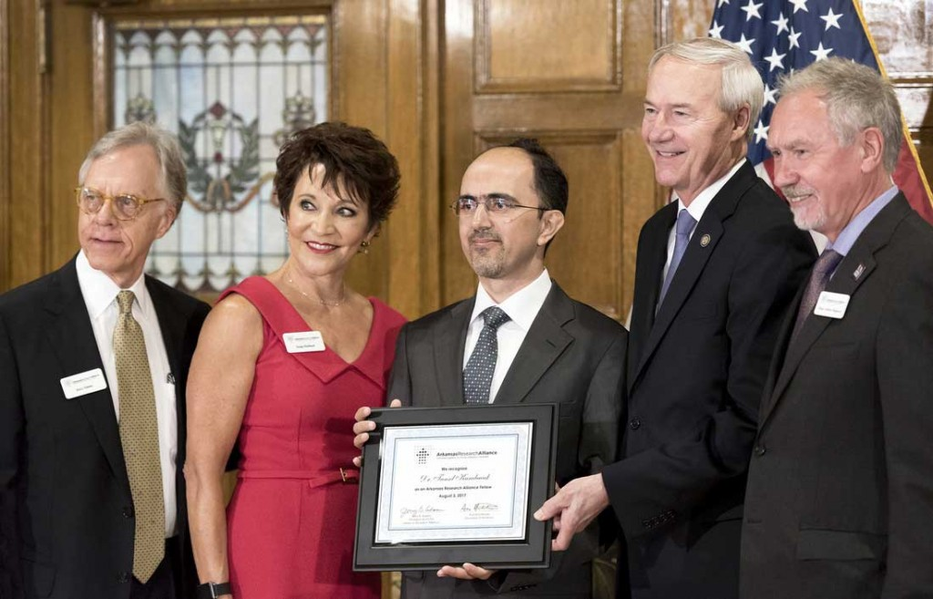 Dr. Tansel Karabacak is one of the 2017 recipients of the Arkansas Research Alliance fellowship. Pictured from left to right is Jerry Adams, Julie LaRue, Tansel Karabacak, Gov. Asa Hutchinson, and Chancellor Andrew Rogerson.