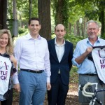 UA Little Rock Cycling Club co-founders Ian Hadden and Martial Trigeaud present Janessa Rogerson and Chancellor Andrew Rogerson with club jerseys.