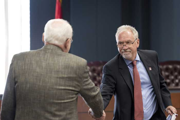 Benton Mayor David Mattingly and Chancellor Andrew Rogerson shake hands during a news conference announcing new bachelor degree programs at the UA Little Rock Benton Campus. Photo by Lonnie TImmons III/UA Little Rock Communications.
