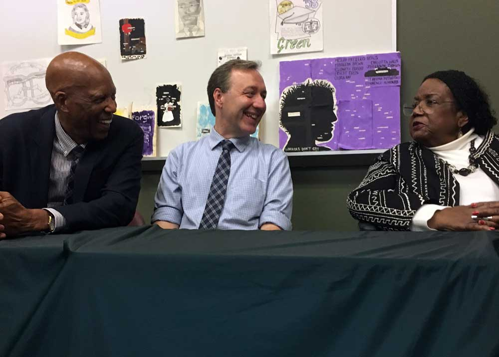 Dr. John Kirk (middle) speaks with members of the Little Rock Nine, Dr. Terrence Roberts (left) and Melba Pattillo Beals (right), during a book signing at Central High Schoo