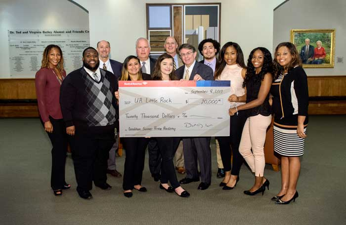 UA Little Rock celebrates a donation from Bank of America to help the Summer Bridge Academy. Pictured in the front row (L to R) are Chris Foy, Laura Montalvan, Eva Legg, Bank of America President Donnie Cook, Sharice Hollister, Xenia Cooley, and Assistant Vice Chancellor for Student Affairs Amber Smith. Back row (L to R) are Kristi Smith, Vice Chancellor for Student Affairs Mark Allen Poisel, Bank of America Senior Vice President John Dominick, Vice Chancellor for University Advancement Christian O'Neal, and Jonathan Bobo, recruitment and enrollment manager. Photo by Lonnie Timmons III/UA Little Rock Communications.