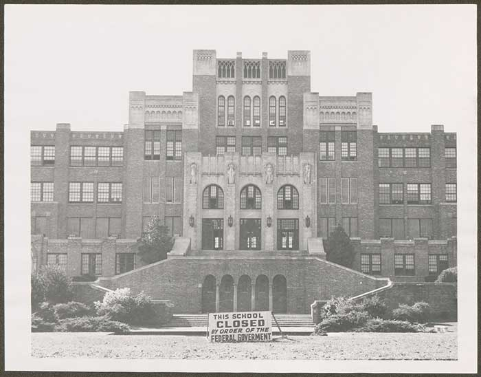 A sign in front of Little Rock Central High School declares the closing of the city's four public high schools, thus beginning the Lost Year of 1958-1959. Photo courtesy of the Center of Arkansas History and Culture.