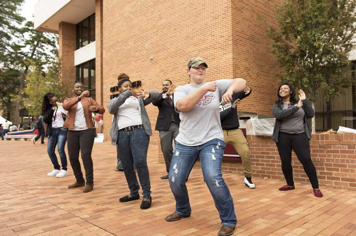 UA Little Rock students and staff line dance during the 2015 Discover event. Photo by Lonnie Timmons III/UA Little Rock Communications.