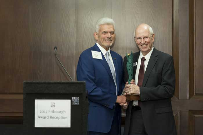 Alfred Williams presents the Fribourgh Award to Jerry Damerow during the Sept. 28 award reception at Pleasant Valley Country Club. Photo by Lonnie Timmons III/UA Little Rock Communications.