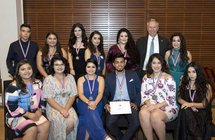 In the upper right photo, Chancellor Andrew Rogerson congratulates UA Little Rock students who received LULAC scholarships during the Oct. 13 gala at the Clinton Presidential Library and Museum. Photo by Lonnie Timmons III/UA Little Rock Communications.