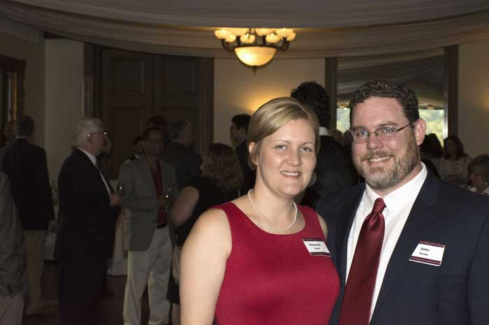 John Siratt (right) and his wife, Cassidy (left, attend the 2016 Fribourgh Award Reception at Pleasant Valley Country Club.