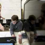 Luke Johnson and Mike Powell work on a physics project in Ottenheimer Library.