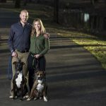 J.T. Pooler, his fiance, Amber Mitchell, walk their two dogs. Photo by Lonnie Timmons III/UA Little Rock Communications.