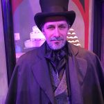Dr. Greg Robinson as Scrooge