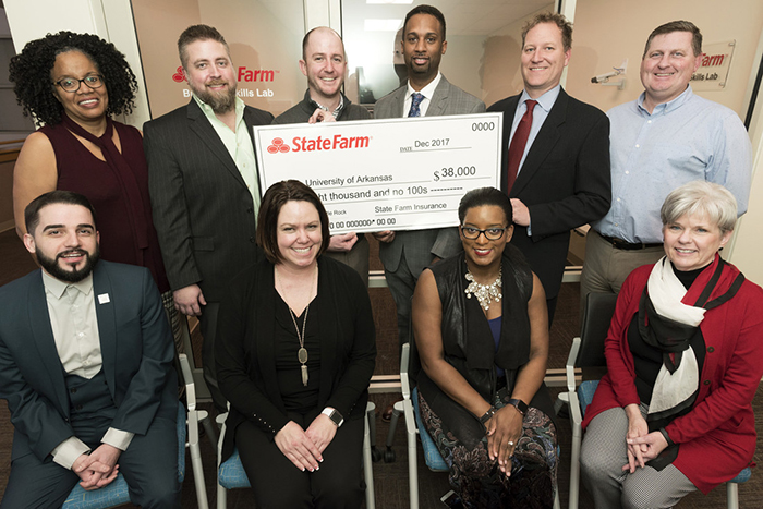 State Farm presents a check to UA Little Rock College of Business in the Business Skills Lab on January 24, 2018.