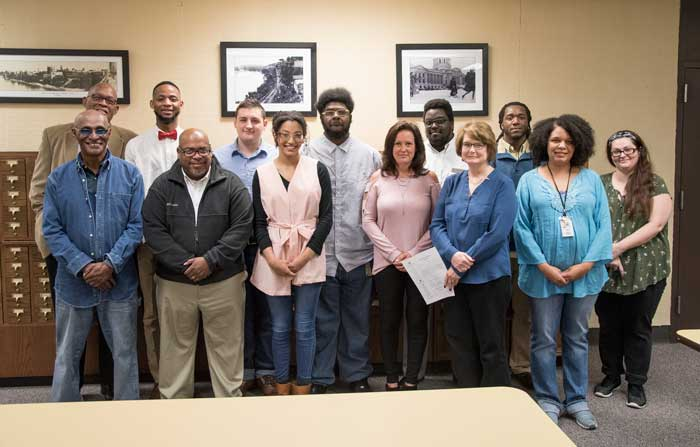 Members of Dr. Brian Mitchell's class include: Back row (L to R): Ellis E. Thompson; Domorion Williams; Grant Burress; Kevin Hill; Benny Mutoni; and Nicholson Weaver. Front Row: John Anderson; Dr. Brian Mitchell; Corrie Green; and Tarrie Boggs.
