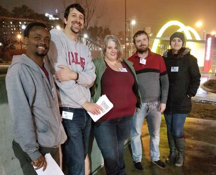 Graduate Student Association members (L to R) Venant Habamungu, Zach Stein, Kathleen Lewis, Parliamentarian Brandon Burdette, and Vice President Diamond McGehee hand out fliers during the Chipotle fundraiser for student travel grants.