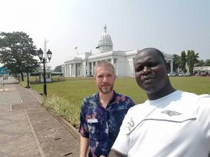 Eric Wiebelhaus-Brahm visits the Sri Lankan parliament building with colleague Stephen Oola.