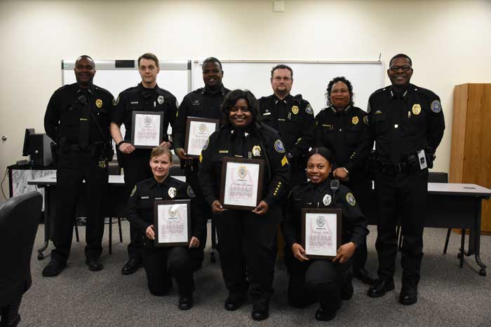 UA Little Rock police officers receive a commendation during a Feb. 2 ceremony for their heroic efforts to save a man's life during a Jan. 2 call. Back row (L to R) include Lt. Jerome Bailey, Officer John Claunch, Cpl. Gary McGee, Lt. Aaron Birmingham, Chief Regina Wade-Carter, and Assistant Chief Johnny Smith. Front row (L to R) include Det. Tonya Carter, Sgt. Marilyn Thompson, and Officer Deshalay Hubbard.